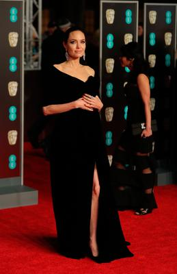 US actress Angelina Jolie poses on the red carpet upon arrival at the BAFTA British Academy Film Awards at the Royal Albert Hall in London on February 18, 2018. / AFP PHOTO / Daniel LEAL-OLIVASDANIEL LEAL-OLIVAS/AFP/Getty Images