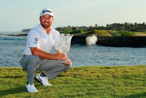 Graeme McDowell shows off the trophy after his first PGA Tour victory since 2015 at the Corales Puntacana Resort & Club Championship.