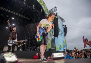 """Green Day frontman Billie Joe Armstrong cheers on a fan singing Green Day's """"Know Your Enemy"""" after she was pulled up on stage at the Ormeau Embankment, Belfast. Wednesday 28th June 2017 Liam McBurney/RAZORPIX"""