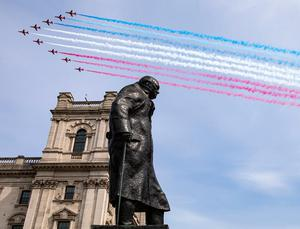Handout photo dated 08/05/20 issued by the MoD of the Royal Air Force Red Arrows flying past the statue of former prime Minister Sir Winston Churchill in Parliament Square, to thank Second World War Veterans and to mark the 75th anniversary of VE Day. PA Photo. Issue date: Friday May 8, 2020. Photo credit should read: SAC Connor Tierney/MoD/Crown Copyright/PA Wire  NOTE TO EDITORS: This handout photo may only be used in for editorial reporting purposes for the contemporaneous illustration of events, things or the people in the image or facts mentioned in the caption. Reuse of the picture may require further permission from the copyright holder.