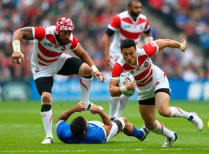 MILTON KEYNES, ENGLAND - OCTOBER 03: Akihito Yamada of Japan makes a break during the 2015 Rugby World Cup Pool B match between Samoa and Japan at Stadium mk on October 3, 2015 in Milton Keynes, United Kingdom.  (Photo by Michael Steele/Getty Images)