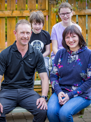 All clear: Juliet McFarland at home with her husband, Eamon, and children, Erin and Callum