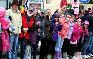 Local cycling fans await the peloton in Glenarm village during stage two of the 2014 Giro D'Italia in Co Antrim. PRESS ASSOCIATION Photo. Picture date: Saturday May 10, 2014. Photo credit should read: Paul Faith/PA Wire