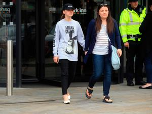 Mother Amy Trippitt and her daughter Grace, who attended the concert at Manchester Arena last night, leave the Park Inn hotel in the city the morning after a suicide bomber killed 22 people, including children, as an explosion tore through fans leaving the pop concert. PRESS ASSOCIATION Photo. Picture date: Tuesday May 23, 2017. See PA story POLICE Explosion. Photo credit should read: Danny Lawson/PA Wire