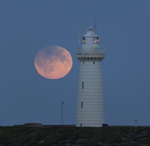 Harvest moon and Penumbral Lunar Eclipse on Friday 16 Sept 2016 at Donaghadee lighthouse. Picture by Bernie Brown