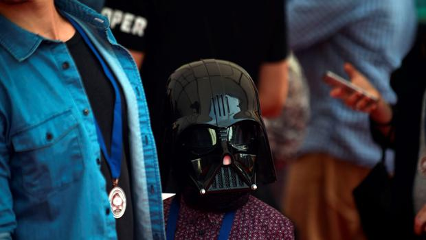 A young fan dressed as a Star Wars character arrives at the Australian premier of 'Star Wars: The Force Awakens' in Sydney on December 16, 2015. Star Wars: The Force Awakens opens to the general public on December 17, 2015. AFP PHOTO / Peter PARKSPETER PARKS/AFP/Getty Images