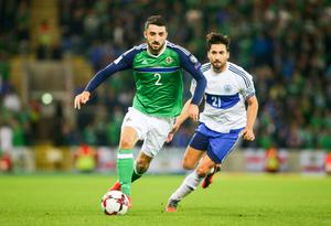 Picture - Kevin Scott  / Press Eye  Northern Ireland's Conor McLauglin and San Marino's Mirko Palazzi in action during the 2018 FIFA World Cup Qualifier and opening game at the newly developed National Stadium - Windsor Park on 8th October 2016 , Belfast , Northern Ireland  Photo by Kevin Scott  / Press Eye