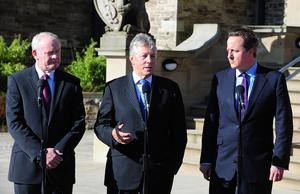 Pacemaker Press Belfast 11-10-2013:  Prime Minister David Cameron has said Northern Ireland is second only to London in the UK as the top destination for inward investment. Mr Cameron is pictured with Northern Irelands First minister Peter Robinson & Deputy First Minister Martin McGuinness at Stormont Castle after attending major investment conference in Belfast. Picture By: Arthur Allison.