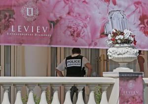 A policeman is seen at the Carlton hotel, in Cannes, southern France, the scene of a daylight raid, Sunday, July 28, 2013. A staggering 40 million euro ($53 million) worth of jewels and diamonds were stolen Sunday from the Carlton Intercontinental Hotel in Cannes, in one of Europe's biggest jewelry heists recent years, police said. French Riviera hotel was hosting a temporary jewelry exhibit over the summer of the prestigious Leviev diamond house, which is owned by Israeli billionaire Lev Leviev. (AP Photo/Lionel Cironneau)