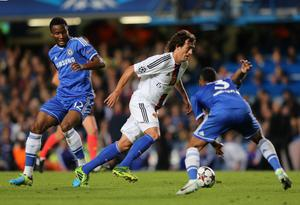 LONDON, ENGLAND - SEPTEMBER 18:  Matias Emilio Delgado of FC Basel is closed down by John Obi Mikel and Ashley Cole of Chelsea during the UEFA Champions League Group E Match between Chelsea and FC Basel at Stamford Bridge on September 18, 2013 in London, England.  (Photo by Ian Walton/Getty Images)