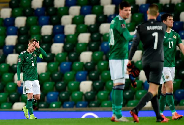 Steven Davis (left) started the night celebrating his record-breaking 126th cap but ended it in disappointment.