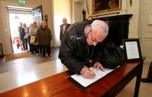 Members of the public sign a book of condolence at Mansion House in Dublin for those killed in the Berkeley balcony collapse. Photo: Niall Carson/PA