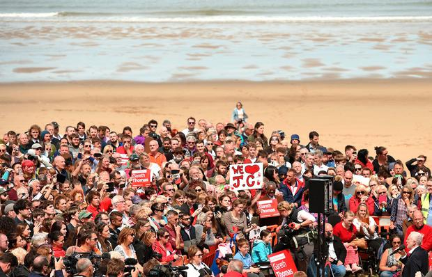 Britain's main opposition Labour Party leader Jeremy Corbyn (bottom R) addresses supporters at a campaign visit in Colwyn Bay, north Wales on June 7, 2017, on the eve of the general election. Britain on Wednesday headed into the final day of campaigning for a general election darkened and dominated by jihadist attacks in two cities, leaving forecasters struggling to predict an outcome on polling day. / AFP PHOTO / Oli SCARFFOLI SCARFF/AFP/Getty Images