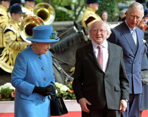 President of Ireland Michael D. Higgins (centre) with Queen Elizabeth II (left) and Prince Charles (right) at Windsor Castle in Berkshire during the president's state visit