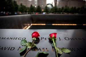 NEW YORK, NY - SEPTEMBER 11:  Flowers are laid at the 9-11 Memorial site on September 11, 2015 in New York City. Today marks the 14th anniversary of the attacks where nearly 3,000 people were killed in New York, Washington D.C. and Pennsylvania.  (Photo by Andrew Burton/Getty Images)