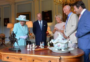 BELFAST, NORTHERN IRELAND - JUNE 25:  In this handout image provided by Harrison Photography, Queen Elizabeth II  and Prince Philip, Duke of Edinburgh talk to Antiques Roadshow experts Hilary Kay, John Axford and Paul Atterbury at Hillsborough castle on June 25, 2014 in Belfast, Northern Ireland. The Royal party are visiting Northern Ireland for three days.  (Photo byAaron McCracken/Harrison Photography via Getty Images)