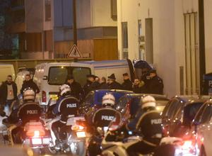 PARIS, FRANCE - JANUARY 07:  Police officers evacuate dead bodies at the offices of the French satirical newspaper Charlie Hebdo in Nicolas Appert street on January 7, 2015 in Paris, France. Armed gunmen stormed the offices leaving twelve dead, including two police officers, according to French officials.  (Photo by Antoine Antoniol/Getty Images)
