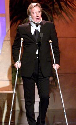 Alan Rickman was the host at 'Hollywood Salutes Bruce Willis: An American Cinematheque Tribute' at the Beverly Hilton Hotel, Beverly Hills, Ca. 9/23/00. Rickman came out onstage with crutches after a clip was shown of him falling to his death in a Bruce Willis film.  Photo:Kevin Winter/ImageDirect.