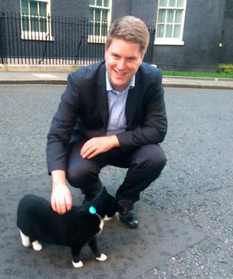 Peter Cardwell with Palmerston the cat outside No 10 Downing Street