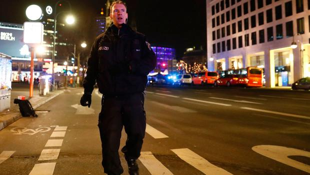 A policeman walks at the site where a truck speeded into a christmas market in Berlin, on December 19, 2016 killing nine persons and injuring at least 50 people. Ambulances and police rushed to the scene after the driver drove up the pavement of the market in a central square popular with tourists less than a week before Christmas, in a scene reminiscent of the deadly truck attack in Nice. / AFP PHOTO / Odd ANDERSENODD ANDERSEN/AFP/Getty Images