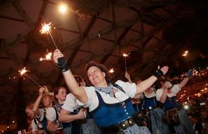 MUNICH, GERMANY - OCTOBER 05:  Waitresses and revellers celebrate with sparklers the last minutes of the 2014 Oktoberfest on October 5, 2014 in Munich, Germany. The 181st Oktoberfest ends today, having drawn visitors from around the globe in the world's largest beer fest.  (Photo by Johannes Simon/Getty Images)