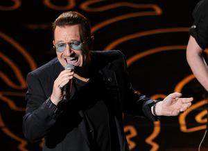 HOLLYWOOD, CA - MARCH 02:  Singer Bono of U2 performs onstage during the Oscars at the Dolby Theatre on March 2, 2014 in Hollywood, California.  (Photo by Kevin Winter/Getty Images)