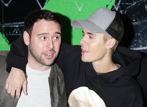 Scooter Braun, pictured here with his client Justin Bieber, is one of the most high-profile talent managers in the industry (Yui Mok/PA)
