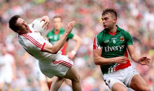 Mayo's Aidan O'Shea tackles Colm Cavanagh of Tyrone which resulted in a yellow card