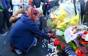 A vigil takes place in Summerhill, Twinbrook, west Belfast, where well-known boxer Eamonn Magee Jnr was stabbed to death.