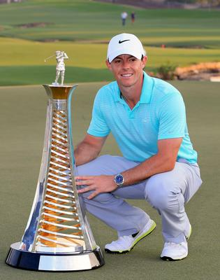 Rory McIlroy of Northern Ireland holds the Race to Dubai trophy at the DP World Golf Championship in Dubai, United Arab Emirates. (AP Photo/STR)