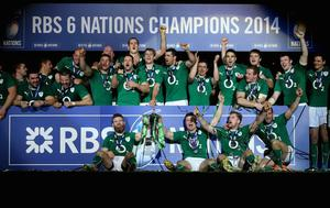 Brian O'Driscoll of Ireland and team mates celebrate with the Six Nations Championship trophy during the RBS Six Nations match between France and Ireland at Stade de France on March 15, 2014 in Paris, France.  (Photo by Julian Finney/Getty Images)
