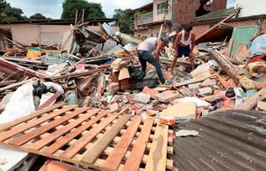 Rescuers and residents search for victims in Jama, in the Ecuadorean coastal province of Manabi, on April 18, 2016 two days after a 7.8-magnitude quake hit the country, on April 18, 2016. Rescuers and desperate families clawed through the rubble Monday to pull out survivors of an earthquake that killed 350 people and destroyed towns in a tourist area of Ecuador. / AFP PHOTO / Juan CevallosJUAN CEVALLOS/AFP/Getty Images