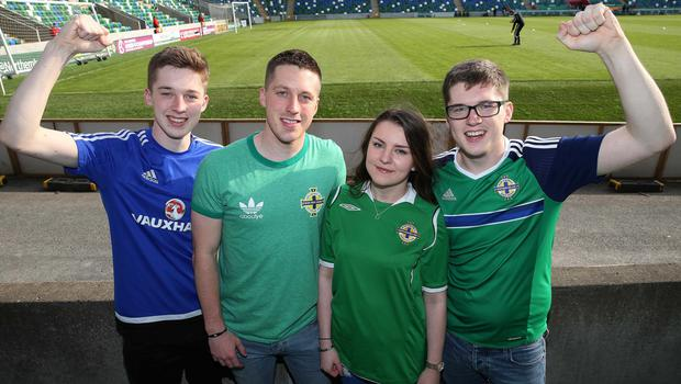 Matthew,Chris,Robyn and Richard Knox from Lisburn  watching  Northern Ireland     and Belarus      during Friday night's Vauxhall Friendly International match  at the National Football Stadium at Windsor Park. Picture by Brian Little/Presseye