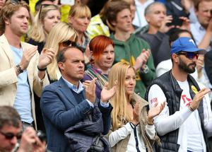 LONDON, ENGLAND - JUNE 25:  Sam Branson (L) and Jelena Ristic (bottom centre), the girlfriend of Novak Djokovic of Serbia watch his Gentlemen's Singles first round match against Florian Mayer of Germany on day two of the Wimbledon Lawn Tennis Championships at the All England Lawn Tennis and Croquet Club on June 25, 2013 in London, England.  (Photo by Julian Finney/Getty Images)