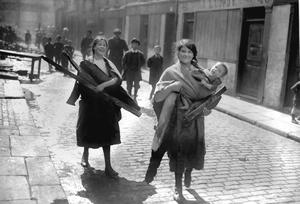 File photo dated 01/05/1916 of children carrying wood from Sackville Street, Dublin after the Rising as a trove of  rarely-seen photographs lays bare the utter carnage wreaked on Dublin during the tumultuous Easter Rising 100 years ago this weekend. PA