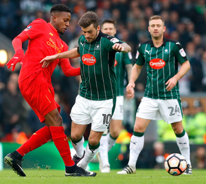 Up for the fight: Liverpool's Divock Origi and Plymouth Argyle's Graham Carey battle for the ball