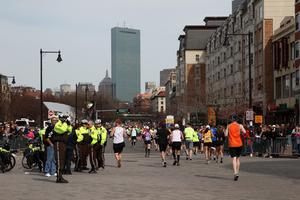 BOSTON, MA - APRIL 15:  Runners and police gather near Kenmore Square after two bombs exploded during the 117th Boston Marathon on April 15, 2013 in Boston, Massachusetts. Two people are confirmed dead and at least 23 injured after two explosions went off near the finish line to the marathon.  (Photo by Alex Trautwig/Getty Images)