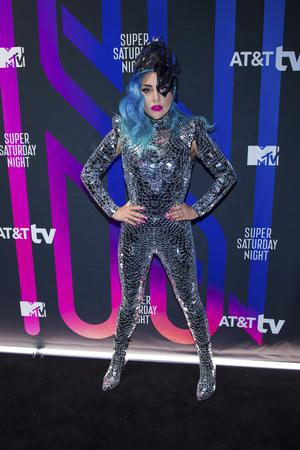 One of Lady Gaga's outfits included a glittery bodysuit and blue hair (Scott Roth/Invision/AP)
