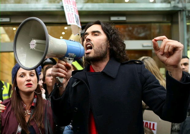 Comedian Russell Brand joins residents and supporters from the New Era housing estate in East London as they demonstrate against US investment company Westbrook?s plans to evict 93 families on December 1, 2014 in London, England. (Photo by Dan Kitwood/Getty Images)