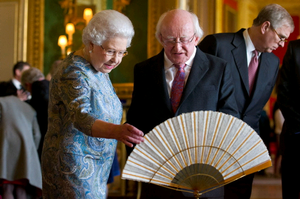Queen Elizabeth II accompanies Irish President Michael D Higgins as he is shown Irish related items from the Royal Collection, in the Green Drawing Room, in Windsor Castle, during the first State visit to the UK by an Irish President.