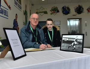 Fans  sign a book of condolence for Former N Ireland and Man Utd star Harry Gregg. Pic Colm Lenaghan/Pacemaker