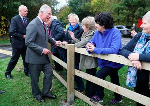 The Prince of Wales meets well-wishers outside the YMCA Londonderry at Drumahoe and Eglinton Community Centre, in Londonderry, during a visit to communities hit by the summer's flash floods.Brian Lawless/PA Wire
