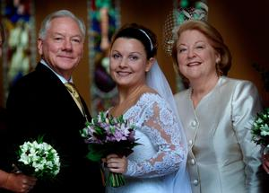 Suzy with her parents on her wedding day