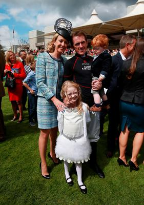 Tony McCoy with his wife Chanelle, daughter Eve and son Archie during the bet365 Jump Finale at Sandown Racecourse, Surrey. PRESS ASSOCIATION Photo. Picture date: Saturday April 25, 2015. See PA story RACING Sandown. Photo credit should read: David Davies/PA Wire