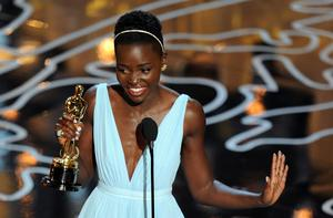 Actress Lupita Nyong'o accepts the Best Performance by an Actress in a Supporting Role award for '12 Years a Slave' onstage during the Oscars at the Dolby Theatre on March 2, 2014 in Hollywood, California.  (Photo by Kevin Winter/Getty Images)