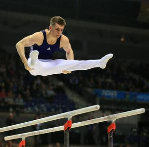 Max Whitlock on the parallel bars during the Artistic Gymnastics British Championships 2016 at the Echo Arena, Liverpool. PRESS ASSOCIATION Photo. Picture date: Sunday April 10, 2016. See PA story GYMNASTICS British. Photo credit should read: Nigel French/PA Wire. RESTRICTIONS: EDITORIAL USE ONLY, NO COMMERCIAL USE WITHOUT PRIOR PERMISSION, PLEASE CONTACT PA IMAGES FOR FURTHER INFO: Tel: +44 (0) 115 8447447.