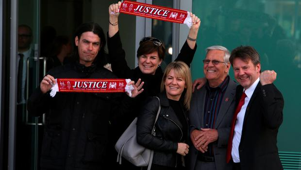 People react as they leave the coroner's court in Warrington, north-west England on April 26, 2016 1989 following the conclusion of the inquest into the 1989 Hillsborough disaster. The 96 Liverpool fans who died in Britain's 1989 Hillsborough football stadium disaster were unlawfully killed, a jury found Tuesday following the longest-running inquest in English legal history. After hearing more than two years of evidence, the jury also concluded that the behaviour of Liverpool supporters on the day did not cause or contribute to Britain's worst sports stadium tragedy.  / AFP PHOTO / GEOFF CADDICKGEOFF CADDICK/AFP/Getty Images
