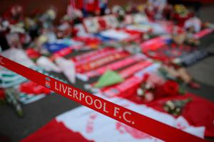 LIVERPOOL, ENGLAND - APRIL 26:  Fresh tributes adorn the Hillsborough Memorial outside Anfield Stadium, the home of Liverpool Football Club on April 26, 2016 in Liverpool, England. The fresh inquests into the 1989 Hillsborough disaster, in which 96 football supporters were crushed to death, concluded today on April 26, 2016 with a verdict of unlawful killing, after the initial verdicts were quashed. Relatives of Liverpool supporters who died in Britain's worst sporting disaster gathered in the purpose-built court to hear the jury's verdict in Warrington after a 25 year fight to overturn the accidental death verdicts handed down at the initial 1991 inquiry.  (Photo by Christopher Furlong/Getty Images)