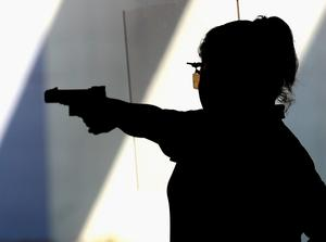 RIO DE JANEIRO, BRAZIL - AUGUST 09:  An athlete competes in the 25m Air Pistol event on Day 4 of the Rio 2016 Olympic Games at the Olympic Shooting Centre on August 9, 2016 in Rio de Janeiro, Brazil.  (Photo by Sam Greenwood/Getty Images)