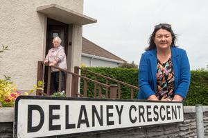 Derry City and Strabane Mayor, Councillor Michaela Boyle with resident Mary Sharkey in Delaney Crescent. It has come to light that the street name has been spelt incorrectly and should be Delany Crescent. The street off Olympic Drive is named after athlete Ronnie Delany from Strabane who won a Gold medal in the 1956 Melbourne Olympics in the 1500m. Picture Martin McKeown. 20.05.20